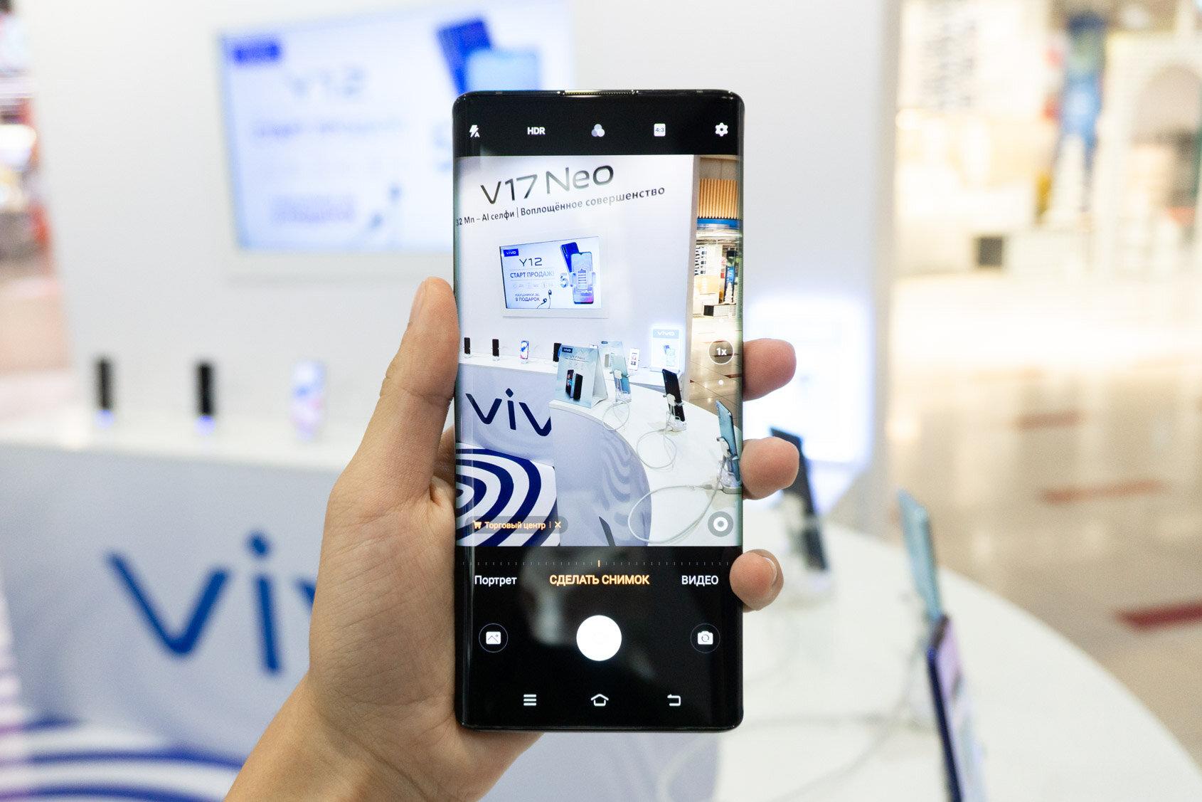 смартфоны с кнопкой фотокамеры сбоку черные глаза видны